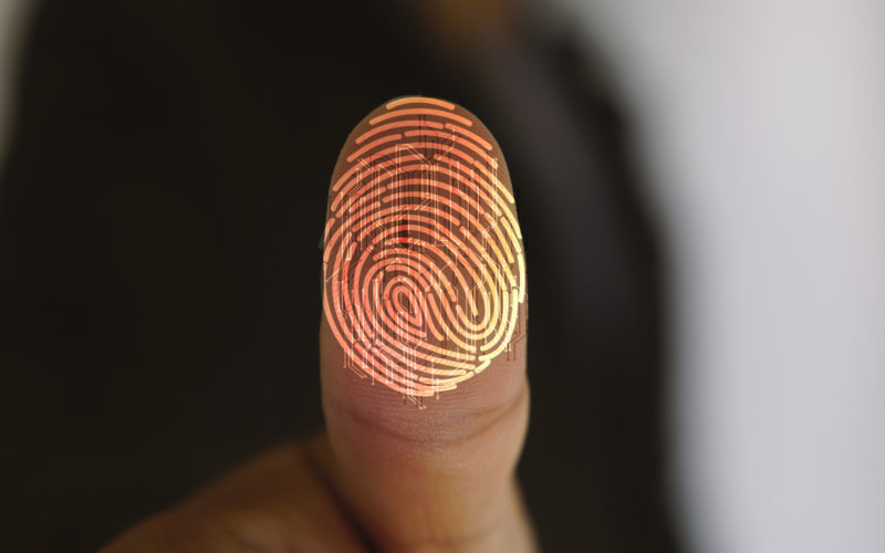 Businessman,Login,With,Fingerprint,Scanning,Technology.,Fingerprint,To,Identify,Personal,